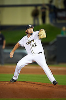 UCF Knights relief pitcher Trent Thompson (42) delivers a pitch during a game against the Siena Saints on February 17, 2017 at UCF Baseball Complex in Orlando, Florida.  UCF defeated Siena 17-6.  (Mike Janes/Four Seam Images)