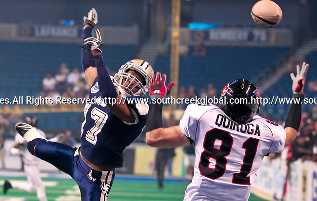 Aug 14, 2010: Tampa Bay Storm defensive back Brandon Hefflin (#17) and Orlando Predator wide receiver Robert Quiroga (#81) fight for the ball. The Storm defeated the Predators 63-62 to win the division title at the St. Petersburg Times Forum in Tampa, Florida. (Mandatory Credit:  Margaret Bowles)