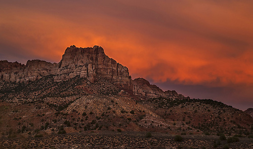 A fiery sunset lights up the sky at Zion National Park Utah