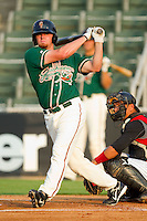 Taylor Krick #17 of the Greensboro Grasshoppers follows through on his swing against the Kannapolis Intimidators at Fieldcrest Cannon Stadium August 2, 2010, in Kannapolis, North Carolina.  Photo by Brian Westerholt / Four Seam Images