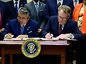 Ambassador Shinsuke Sugiyama, Ambassador of Japan to the United States, left, and US Trade Representative Robert Lighthizer, right, sign the US-Japan Trade Agreement and US-Japan Digital Trade Agreement in the Roosevelt Room of the White House in Washington, DC on Monday, October 7, 2019.<br /> Credit: Ron Sachs / Pool via CNP
