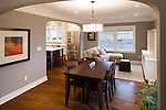 Curved archways connect the dining room, family room, and kitchen areas of a newly remodeled home.