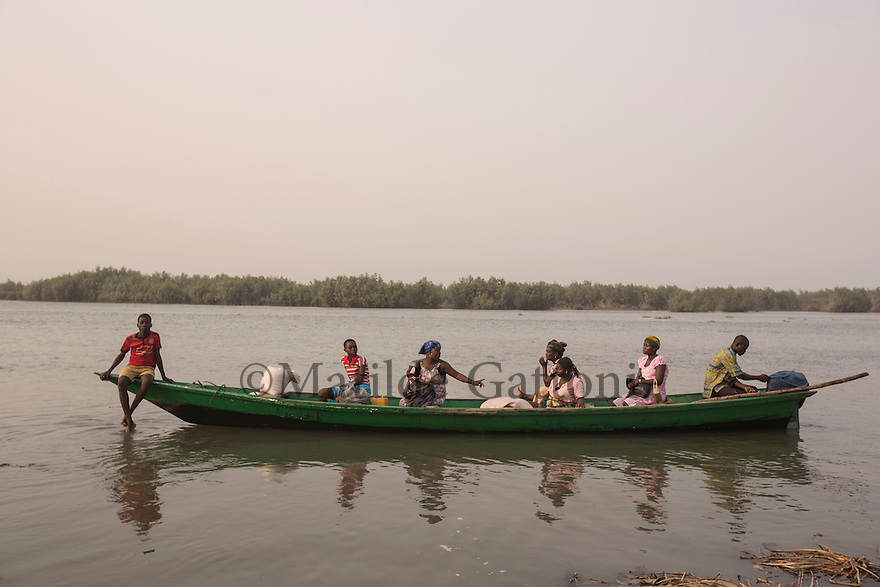 Ghana - Volta region - A passenger's boat sails along the Volta river. <br /> Sea level rise and coastal erosion are affecting more than 7,000 km of West African coast, from Mauritania all the way to Cameroon. Sea levels along the West African coast are expected to rise faster than the global average.