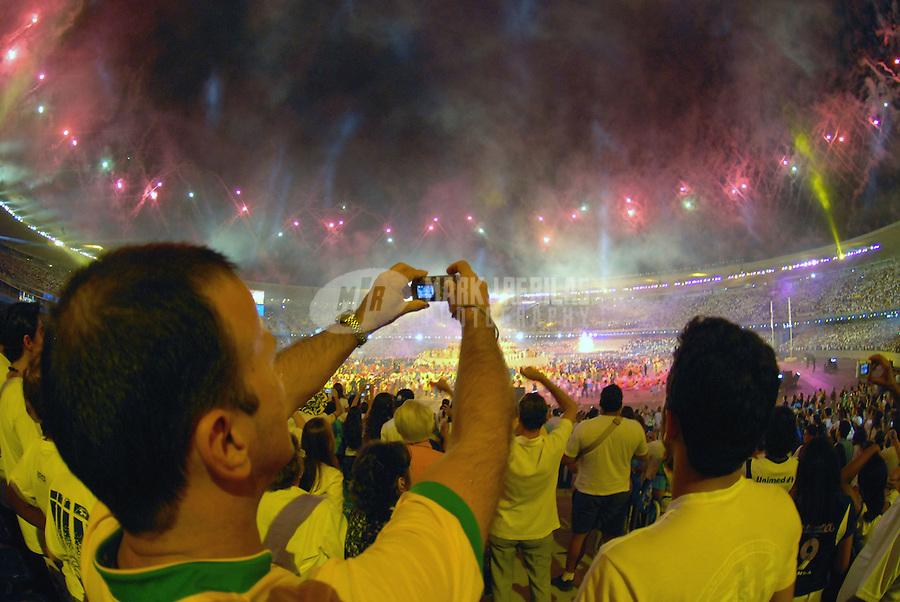 Jul 13, 2007; Rio de Janeiro, Brazil; A fan photographs the fireworks display during opening ceremonies for the Pan American Games at Maracana Stadium in Rio de Janeiro. Mandatory Credit: Mark J. Rebilas-US PRESSWIRE Copyright © 2007 Mark J. Rebilas