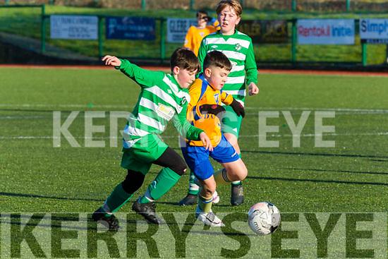 Rioghan O'Sullivan Killorglin and Odran O'Shea Killarney Celtic battle for possesion during their league game in Celtic Park on Saturday