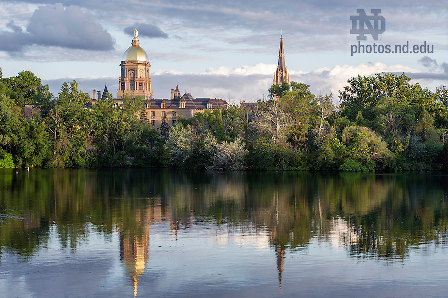June 26, 2014; St. Joseph Lake with the Golden Dome and Basilica of the Sacred Heart before sunset.<br />