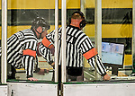 13 November 2015: NCAA Officials Shane Belanger and Patrick Silva review a video replay in the third period of a game between the Providence College Friars and the University of Vermont Catamounts at Gutterson Fieldhouse in Burlington, Vermont. The Lady Friars defeated the Lady Cats 4-1 in Hockey East play. Mandatory Credit: Ed Wolfstein Photo *** RAW (NEF) Image File Available ***