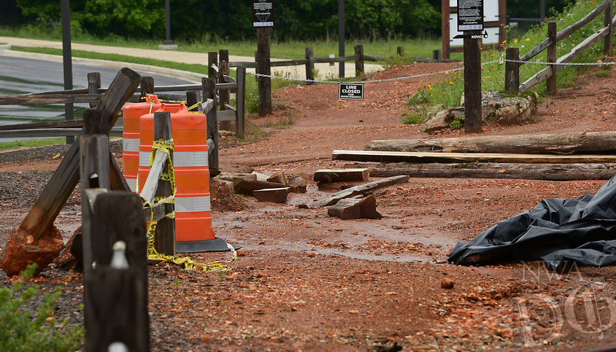 NWA Democrat-Gazette/BEN GOFF @NWABENGOFF<br /> Barriers close off a washed out path Friday, May 12, 2017, at The Railyard Bike Park in Rogers, which has been closed since heavy rain in April. Rogers plans to reopen some of Lake Atalanta park South of Walnut Street on Saturday, but The Railyard will remain closed for the time being.