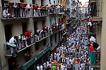 Third day of running bull during San Fermin festival 2014, in Pamplona, Spain. Revelers from around the world arrive to Pamplona every year to take part in the running bulls of San Fermin. Photo by Jose Luis Cuesta.
