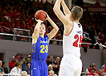 VERMILLION, SD - JANUARY 24: Reed Tellinghuisen	 #23 from South Dakota State University spots up for a jumper over Tyler Hagedorn #25 from the University of South Dakota during their game Wednesday night at the Sanford Coyote Sports Center in Vermillion, SD. (Photo by Dave Eggen/Inertia)