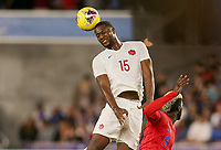 ORLANDO, FL - NOVEMBER 15: Doneil Henry #15 of Canada heads a ball during a game between Canada and USMNT at Exploria Stadium on November 15, 2019 in Orlando, Florida.