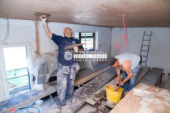 Men plastering the ceiling,