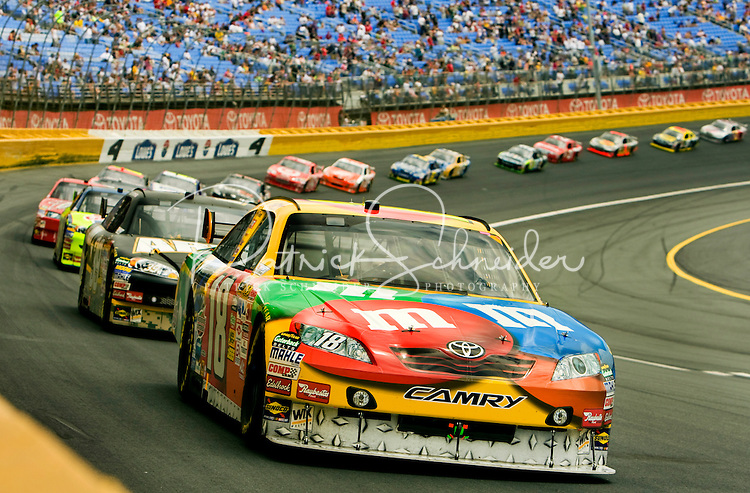 The No. 18 M&M/Interstate Batteries Toyota Camry, driven by NASCAR driver Kyle Busch for Joe Gibbs Racing, leads the pack during a lap of the 2009 Coca-Cola Classic 600 race at the Lowe's Motor Speedway, in Concord, NC. NASCAR Driver David Reutimann ultimately won the race, and his first Sprint Cup, during the rain-shortened event, held May 25, 2009. NASCAR's longest scheduled race went only 227 laps, or 340.5 miles, before officials ended it because of rain. The 2009 race was the 50th running of the Coca-Cola 600. Ryan Newman and Robby Gordon finished second and third respectively.