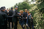 Miners Strike. Orgreave Near Rotherham Yorkshire 1984. Miner helped away from the picket line by colleagues.