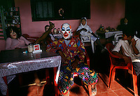 Parties continue in bars and in the street after Day of the Dead on the Pan American highway.  The celebrators stopped buses and trucks asking for money. A cross between Halloween and Day of the Dead, the costumed men were dressed as transvestites, clowns, devils, Che and Hitler.  Tanked up on alcohol, the party continued for several days.