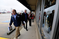 NWA Media/ J.T. Wampler - Philip Taldo, left, and Springdale school superintendent Dr. Jim Rollins lead Springdale school board members and administrators on a tour of a property Monday Dec. 22, 2014 at the corner of Jones Rd. and West Sunset Ave.