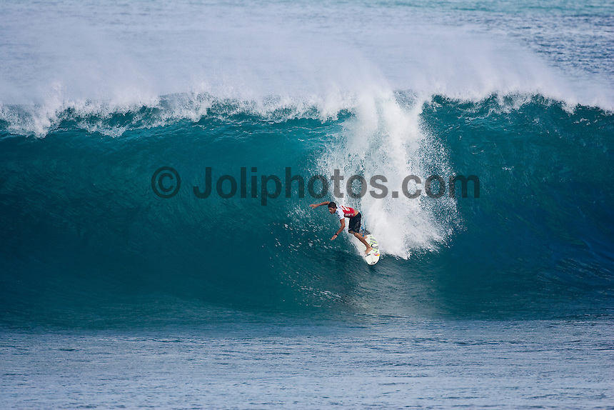 PIPELINE, Oahu/Hawaii (Thursday, December 10, 2009) Bruce Irons (HAW) - Round 1 of the Billabong Pipeline Masters, Event No. 10 of 10 on the 2009 ASP World Tour, commenced today in clean six-to-ten foot (2 - 3 metre) waves at the Banzai Pipeline...The third and final event in the Vans Triple Crown (an ASP Specialty Series), the Billabong Pipeline Masters plays host to two dramatic story arcs: the showdown for the 2009 ASP World Title and the requalification race for the 2010 ASP Dream Tour. Amidst the world's best surfers exists a spattering of Pipeline specialists, making the competition field particularly challenging to navigate...Michael Picon (FRA), 30, current ASP World No. 39, is in need of an impressive result in the final event of the year to secure his position amongst the world's elite in 2010. Today, the Frenchman put the rest of the draw on notice, first eliminating wildcard Manoa Drollet (PYF) before posting the highest heat total of the event, a 19.76 out of a possible 20, for a brilliant backhand tube-riding approach to take out Josh Kerr (AUS), 25, in the final heat of the day.. This event is the last World Championship event of the year and will decide the 2009 World Tilte between Joel Parkinson (AUS) and Mick Fanning (AUS)...The northern hemisphere winter months on the North Shore signal a concentration of surfing activity with some of the best surfers in the world taking advantage of swells originating in the stormy Northern Pacific. Notable North Shore spots include Waimea Bay, Off The Wall, Backdoor, Log Cabins, Rockpiles and Sunset Beach... Ehukai Beach is more  commonly known as Pipeline and is the most notable surfing spot on the North Shore. It is considered a prime spot for competitions due to its close proximity to the beach, giving spectators, judges, and photographers a great view...The North Shore is considered to be one the surfing world's must see locations and every December hosts three competitions, which make up the Triple Crown of
