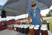 NWA Democrat-Gazette/FLIP PUTTHOFF <br /> JAM SESSION<br /> Jake Kettner of Sulphur Springs shows Wednesday July 10 2019 some of the home-made jams and jellies he sells, along with produce, at his roadside stand in the Hiwasse community. Kettner sells jams, jellies, fruits and vegetables at Arkansas 72 and 340 during summer, then switches to pumpkins and other seasonal goods during autumn.