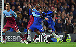 Callum Hudson Odoi of Chelsea is challenged by Angelo Ogbonna of West Ham United  during the Premier League match at Stamford Bridge, London. Picture date: 30th November 2019. Picture credit should read: Robin Parker/Sportimage