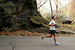 A runner emerges from a tunnel on Kelly Drive during the Philadelphia Marathon in Philadelphia, Pennsylvania on November 19, 2006.
