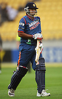 India's Suresh Raina keeps his bat handle dry as he walks off after the third rain stoppage during the 2nd ODI cricket match between the New Zealand Black Caps and India at Westpac Stadium, Wellington, New Zealand on Friday, 6 March 2009. Photo: Dave Lintott / lintottphoto.co.nz