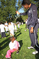 "Briana Scurry of the Washington Freedom during a  D.C United clinic in support of first lady Michelle Obama's ""Let's Move"" initiative on the White House lawn, in Washington D.C. on October 7 2010."