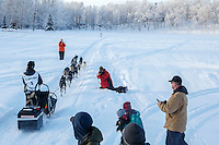 Bailey Schaeffer leaves the start line at Knik during the start of the Junior Iditarod on Saturday February 25, 2017. <br /> <br /> <br /> Photo by Jeff Schultz/SchultzPhoto.com  (C) 2017  ALL RIGHTS RESVERVED