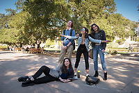 From left, Clark Leazier '18, Kelsey Walter '18, Bebe Terino '19 and Alex Gambee '18 (bottom) celebrate the first day of their last year.<br /> First day of classes, January 22, 2018.<br /> (Photo by Marc Campos, Occidental College Photographer)