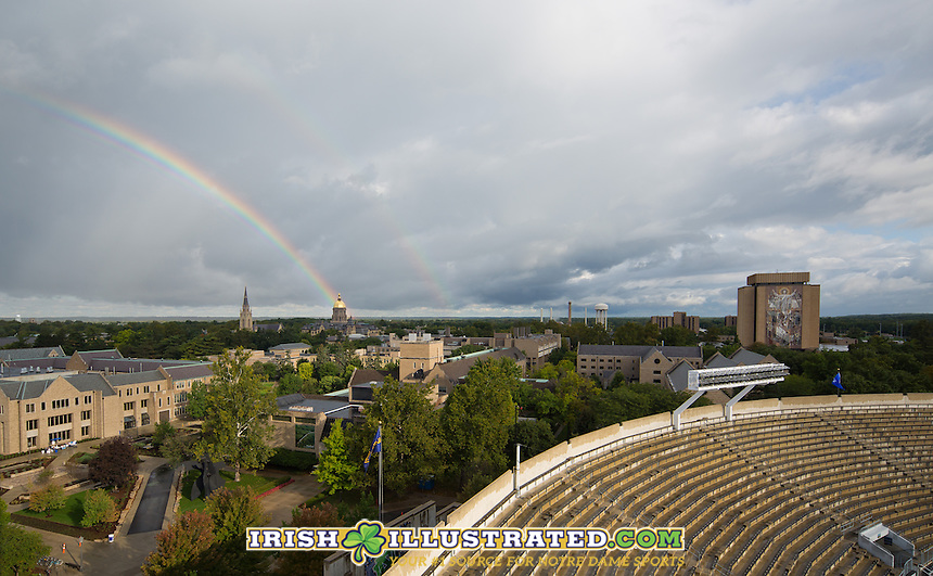 A rainbow appears over the Notre Dame campus before the game.