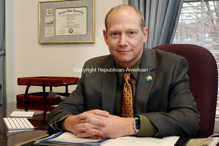 WINSTED CT. 01 DECEMBER 2015-120215SV02-Michael Rooke , president, Northwestern Connecticut Community College  works in his office in Winsted Wednesday.<br /> Steven Valenti Republican-American