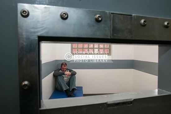 Prisoner being held in police cells