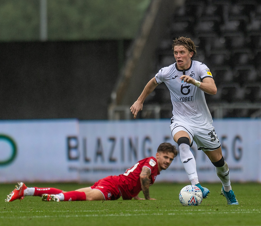 Swansea City's Conor Gallagher (right) after holding off the challenge from Bristol City's Jamie Paterson (left) <br /> <br /> Photographer David Horton/CameraSport<br /> <br /> The EFL Sky Bet Championship - Swansea City v Bristol City- Saturday 18th July 2020 - Liberty Stadium - Swansea<br /> <br /> World Copyright © 2019 CameraSport. All rights reserved. 43 Linden Ave. Countesthorpe. Leicester. England. LE8 5PG - Tel: +44 (0) 116 277 4147 - admin@camerasport.com - www.camerasport.com