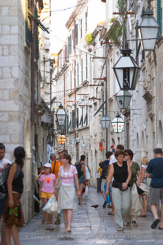 The narrow Od Puca shopping street with crowds of tourists Dubrovnik, old city. Dalmatian Coast, Croatia, Europe.