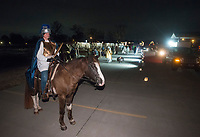NWA Democrat-Gazette/BEN GOFF @NWABENGOFF<br /> Ginger Smittle of Cave Springs and her horse Bullet act in a Bethlehem market scene Thursday, Dec. 6, 2018, during a presentation of the 'Bethlehem Revisited' drive-through live nativity scene at Lakeview Baptist Church in Cave Springs. This is the second year the church has done the live nativity scene, with more showings scheduled each night from 6:00 p.m. to 8:00 p.m. though Sunday, weather permitting. A cast of fifty human characters share the spotlight with roughly twenty live animals including horses, goats, chickens and donkeys.