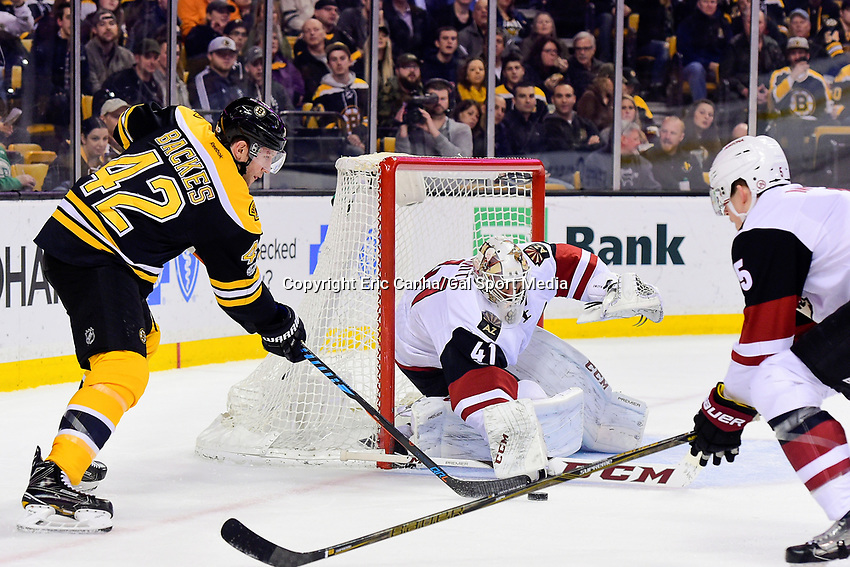 Tuesday, February 28, 2017: Boston Bruins right wing David Backes (42) shoots on Arizona Coyotes goalie Mike Smith (41) during the National Hockey League game between the Arizona Coyotes and the Boston Bruins held at TD Garden, in Boston, Mass. Boston defeats Arizona 4-1. Eric Canha/CSM
