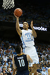 28 December 2015: North Carolina's Brice Johnson (11) and UNC Greensboro's Francis Alonso (ESP) (10). The University of North Carolina Tar Heels hosted the UNC Greensboro Spartans at the Dean E. Smith Center in Chapel Hill, North Carolina in a 2015-16 NCAA Division I Men's Basketball game. UNC won the game 96-63.