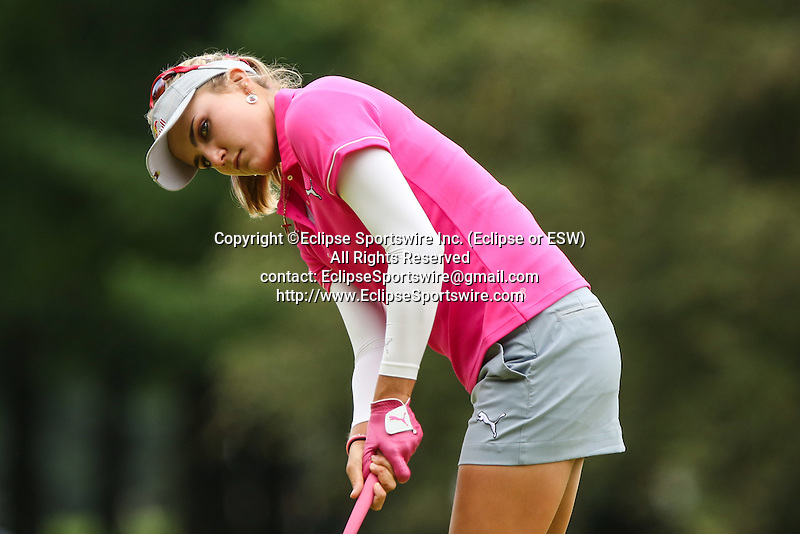 Lexi Thompson watches her putt on the 1st green at the LPGA Championship 2014 Sponsored By Wegmans at Monroe Golf Club in Pittsford, New York on August 16, 2014