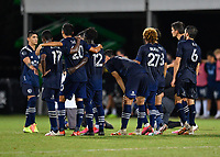 LAKE BUENA VISTA, FL - JULY 26: Alan Pulido of Sporting KC celebrates his shootout goal with his teammates during a game between Vancouver Whitecaps and Sporting Kansas City at ESPN Wide World of Sports on July 26, 2020 in Lake Buena Vista, Florida.