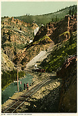 Main track curving along stream.  Train is in distance.  Sidings for loading.  See duplicate RD036-020.  &quot;6751 Eagle River Canyon, Colorado.&quot;<br /> D&amp;RG  Eagle River Canyon, CO