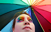 BOGOTA, COLOMBIA - JUNE 30: A woman holding a giant rainbow umbrella during the gay pride parade in Bogota, on June 30, 2019. (Photo by VIEWPRESS/Leonardo Muñoz)