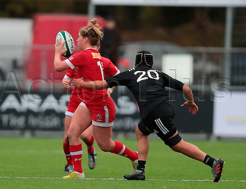23.11.2016. Donnybrook Stadium, Dublin, Ireland. November Series. Canada women versus New Zealand women.<br /> Emily Belchos (Canada) offloads as she is tackled by Angie Sisifa (New Zealand). New Zealand won the match by a score of 20-10.
