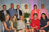 NWA Democrat-Gazette/CARIN SCHOPPMEYER Susan Goss (seated, from left), Sarah Hickmn Gilmer, Jan Shinall, Cookie Parker, Julie Gehrki, James Vawter (standing, from left) Mike Girth, Bryan Looney, Adam Maass and Becky and Kent Shaffer, Saving Grace Board of Directors members welcome guests to Butterflies and Blooms on April 20.