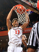 Virginia forward Anthony Gill (13) dunks the ball over Georgia Tech forward Quinton Stephens (12) during an NCAA basketball game Thursday Jan. 22, 2015, in Charlottesville, Va. Virginia defeated Georgia Tech 57-28. (Photo/Andrew Shurtleff)