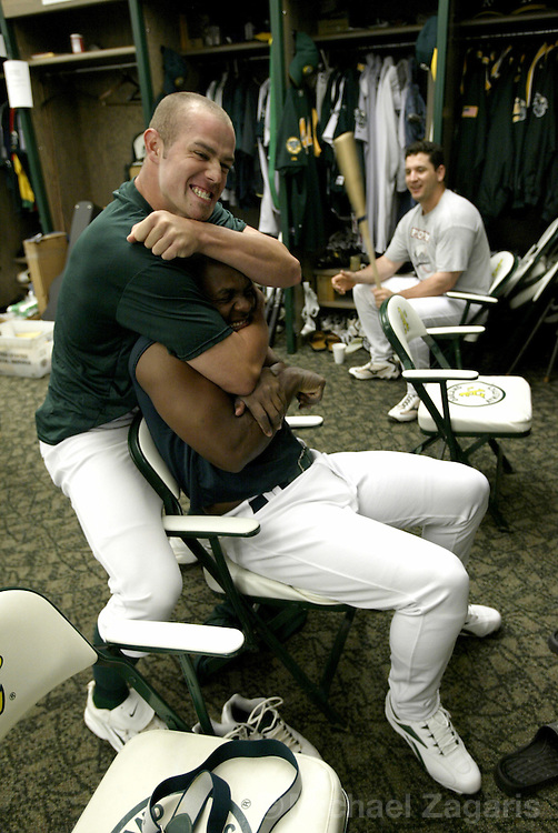 OAKLAND, CA - JUNE 27:  Bobby Crosby goofs around with Esteban German of the Oakland Athletics during the MLB game against the San Francisco Giants at Network Associates Coliseum on June 27, 2004 in Oakland, California. The Giants defeated the Athletics 5-2. (Photo by Michael Zagaris/MLB Photos via Getty Images)