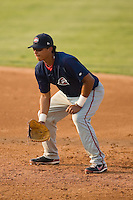 First baseman Carlos Fernandez-Oliva (12) of the Greenville Drive on defense at Fieldcrest Cannon Stadium in Kannapolis, NC, Sunday August 10, 2008. (Photo by Brian Westerholt / Four Seam Images)