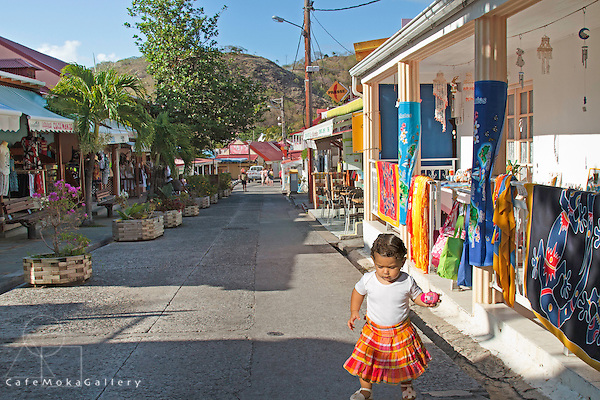 Girl toddler playing in the street in Martiniquaise skirt in Ile des Saintes