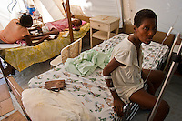 The ill and injured in a Médecins Sans Frontières field hospital in Jacmel. The neighboring hospital structure was damaged in the 7.0 earthquake that killed hundreds of thousands of people. January's earthquake killed hundreds of thousands of people and caused significant and lasting structural and economic damage in the Caribbean nation.