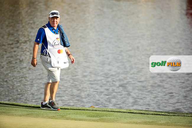 Tyrrell Hatton (ENG) caddy  Michael Donaghy on the 18th during the final round of the Arnold Palmer Invitational presented by Mastercard, Bay Hill, Orlando, Florida, USA. 08/03/2020.<br /> Picture: Golffile | Scott Halleran<br /> <br /> <br /> All photo usage must carry mandatory copyright credit (© Golffile | Scott Halleran)