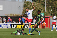 Joan Luque of Dagenham and Redbridge and Gus Mafuta of Hartlepool United during Dagenham & Redbridge vs Hartlepool United, Vanarama National League Football at the Chigwell Construction Stadium on 14th September 2019