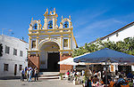 People gather in cafes and by the baroque church of San Juan at Zahara de la Sierra, Spain Sunday 13 October 2013 after the National Day holiday